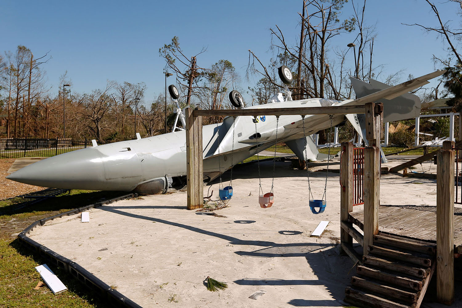 IRS Extends Deadlines for Victims of Hurricane Michael, destruction, playground, swings, airplane crashed