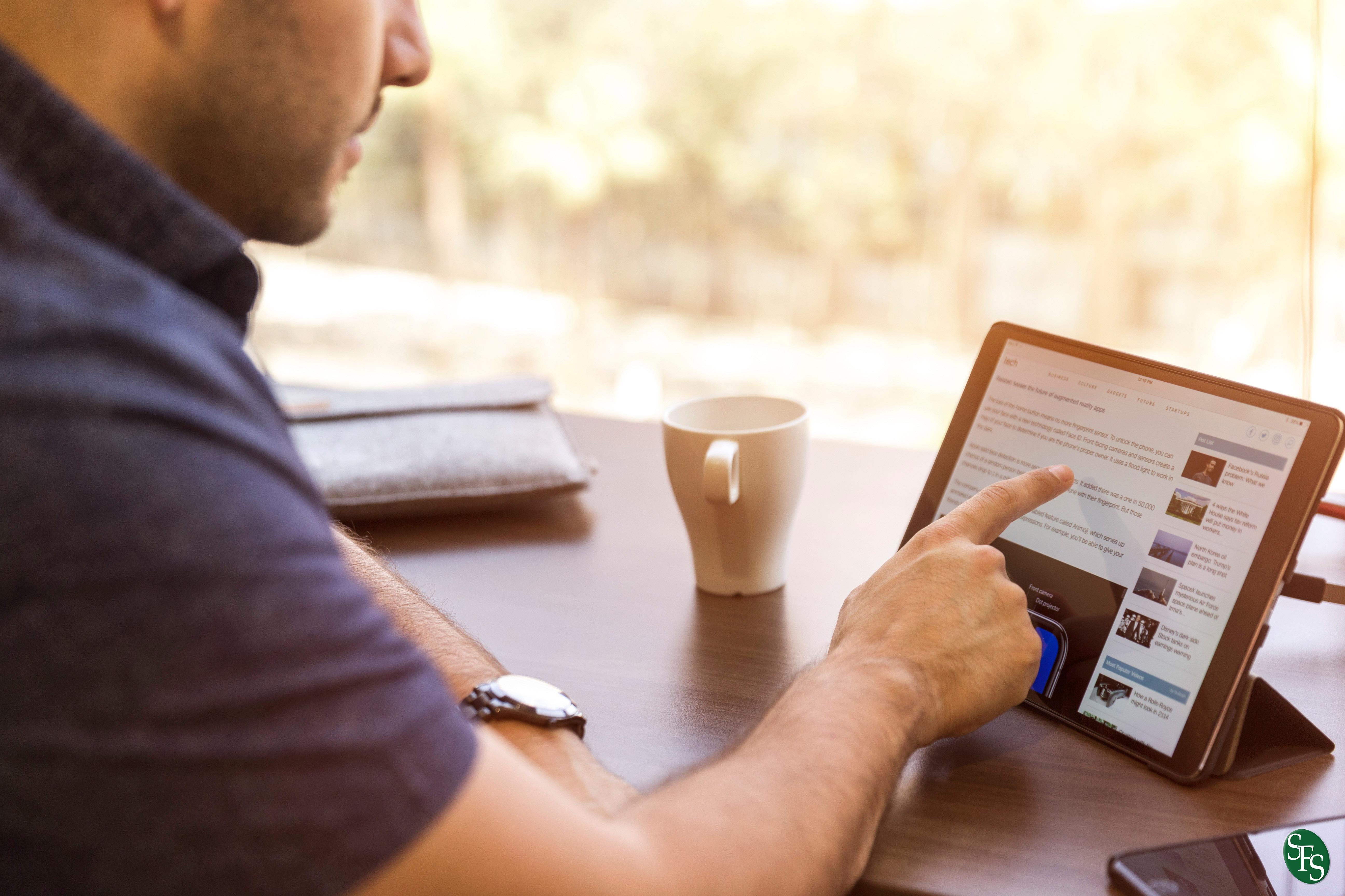 4 Tips on Safely Donating Online, man, ipad, coffee, table