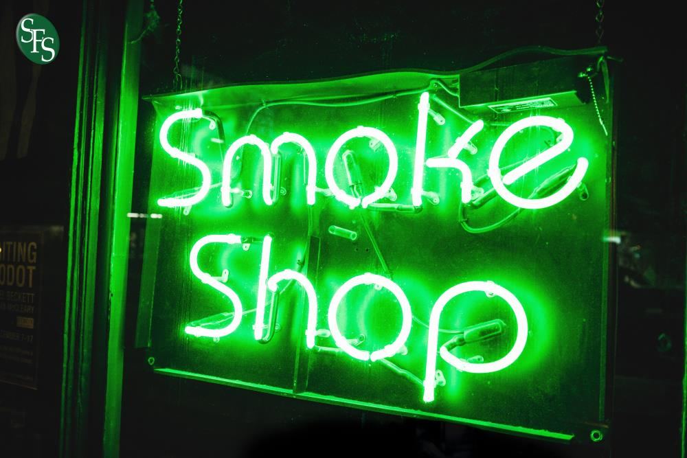 Cannabusiness Income Going Up in Smoke, smoke shop, neon sign