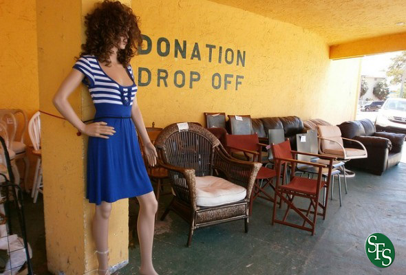 IRS Releases Dirty Dozen, girl, manikin, donation drop off