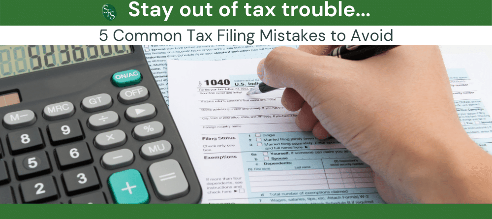 Hand filling out 104-Stay Out of Tax Trouble By Avoiding These 5 Common Tax Filing Mistakes